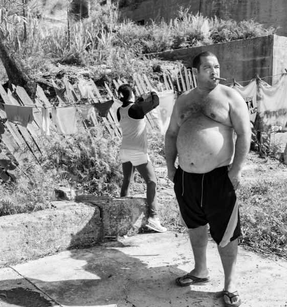 Cuban man and wife hanging laundry