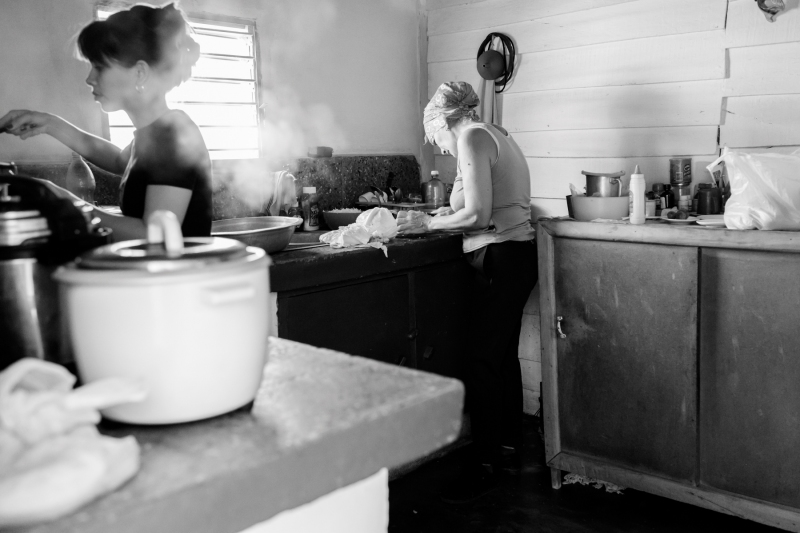 Women preparing food in Cuban kitchen