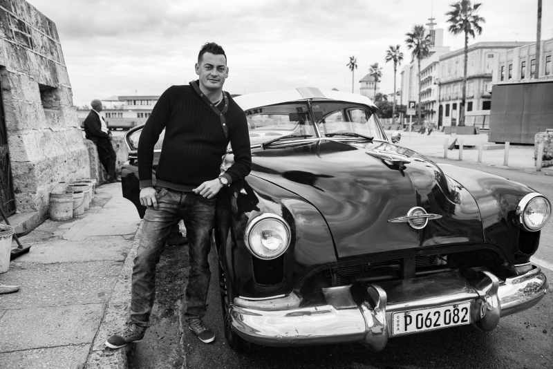 man with his 1949 car in Havana