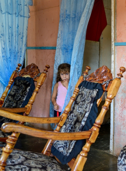 Girl in the curtains, Guanimar, Cuba